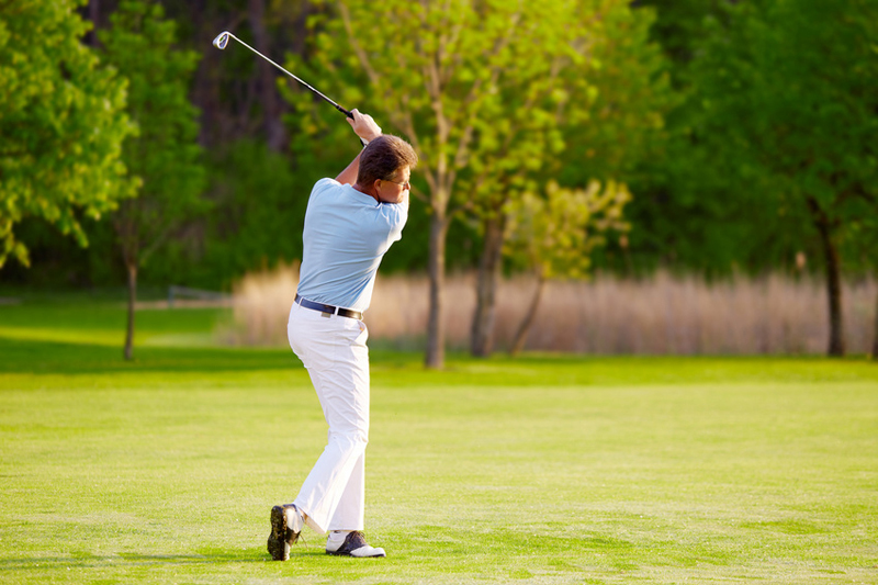 golf player on the golf course at tee-off
